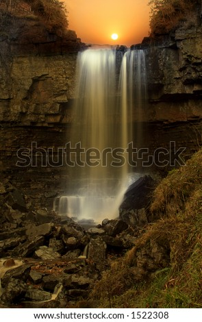 Night Falls, surreal effect created with Sunset on fifty foot waterfall under a Bridge called Ashgill Force in Northumberland England