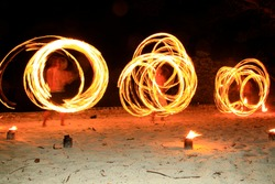 Night fire show on the beach