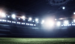 Night football arena in lights close up