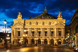 Night front view of the Opera National de Paris. Grand Opera (Opera Garnier) is famous neo-baroque building in Paris. Designed by Charles Garnier in 1875.