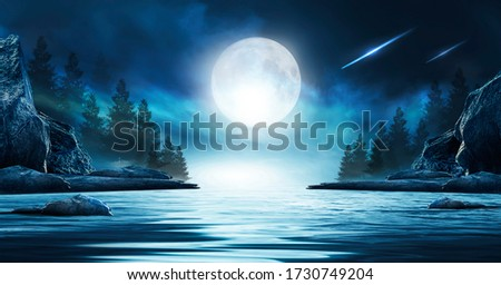Night futuristic seascape. Reflection of the moon on sea water. Large stones, rocks on the shore, trees. Rays of meteorites, neon blue light. Night landscape, islands. Foto stock ©