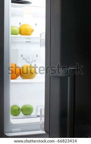 Night Hunger: fridge with fruits in dark room