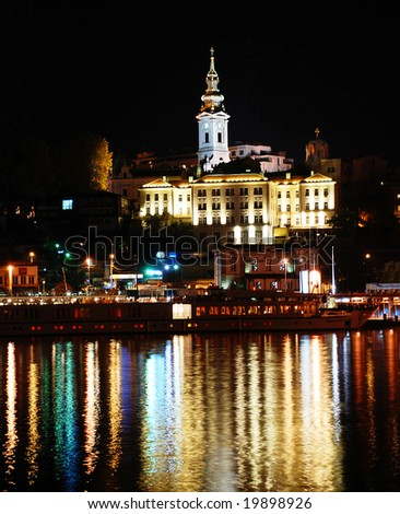 night illuminated Belgrade from river with light reflection