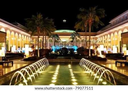 Night illumination of luxury hotel and illuminated fountains, Tenerife island, Spain