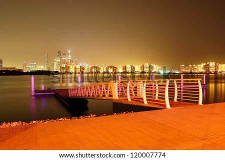 Night illumination of the luxury hotel on Palm Jumeirah man-made island, Dubai, UAE - stock photo