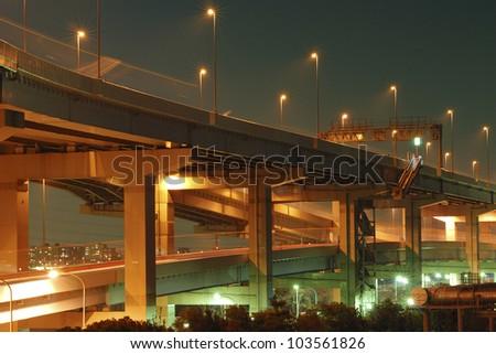 night illumination on the modern hanged up highway in Tokyo, Japan
