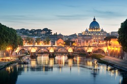 Night image of River Tiber, including: Ponte Sant Angelo and St. Peter's Basilica in the background. Rome - Italy.