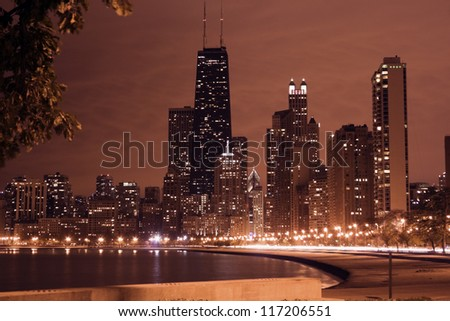 Night in Chicago - Gold Coast buildings and Lake Michigan.