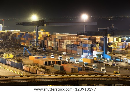 night industrial port.  containers and trucks