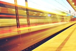 Night landscape, long exposure of a passing-by passenger train. In Motion