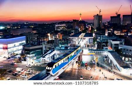Night landscape of Daegu city in Korea with a monorail station and tower her landmark