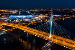 night landscape of the city of Saint Petersburg, a modern bridge over the river, top view