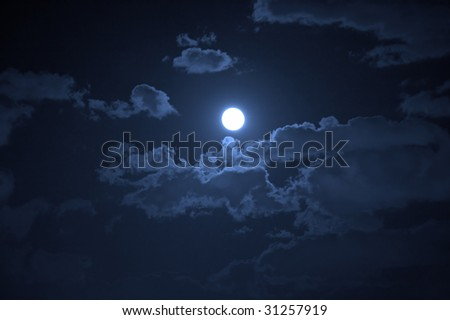 Night landscape of the cloudy sky and the moon
