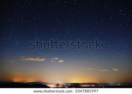 Night landscape. View of the starry sky in winter in the foothills of the Caucasus #1047885997