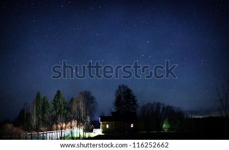 night landscape, village house under the stars at night