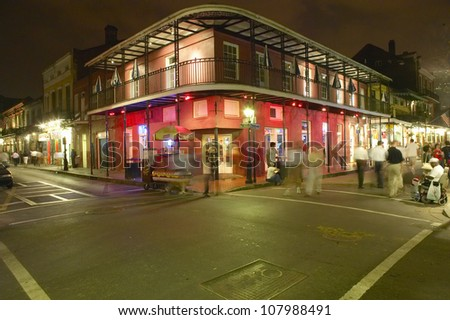 Night life with lights on Bourbon Street in French Quarter New Orleans, Louisiana