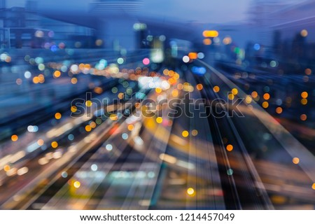Night light bokeh city downtown over train track motion, abstract background #1214457049