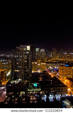 Night light scene of tall buildings in downtown San Diego, California - stock photo