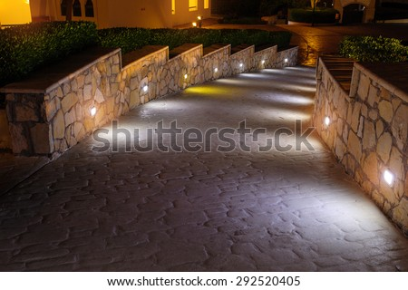 Shutterstock Night lighting path for walks in the hotel.