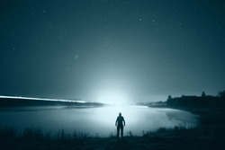 night man at Lake starry sky space alien