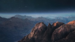 Night mountains before sunrise in the Egypt. Sinai Peninsula, the mountain of Moses. Landscape with the stars  and milky way.