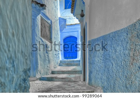 Night on blue shaded city streets of Chefchaouen, Morocco