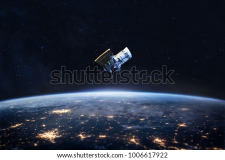 Night on the Earth and satellite in the space. City lights on planet. Civilization. Elements of this image furnished by NASA