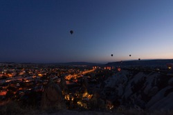 Night panorama of Goreme. Balloons take off at sunrise. Goreme, Cappadocia, Turkey. Famous center of balloon fligths.
