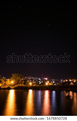 night panorama of Lake Velence and illuminated Bence hill view, Stars lake and hill at night in Velence, Hungary, Éjszakai panoráma a Velencei-tóval és a kivilágított Bence hegyi kilátóval Stock fotó ©