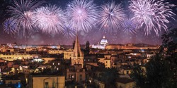 Night panorama of Rome with fireworks on the black sky, Italy