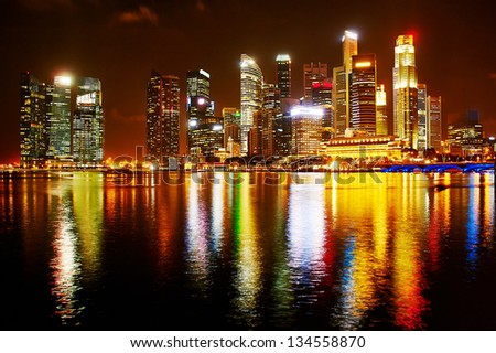 Night panorama of Singapore downtown. There are more than 7,000 multinational corporations from United States, Japan and Europe in Singapore.