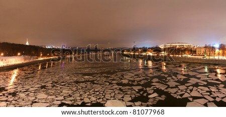 Night panorama of the winter river and a big sports arena of the Olympic Complex Luzhniki, Moscow, Russia