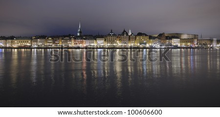 Night panorama over Stockholm Old Town with Skeppsbron, church towers and the Royal Palace