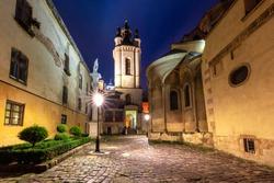 Night panoramic view of Armenian Cathedral of Lviv, Ukraine. Armenian courtyard