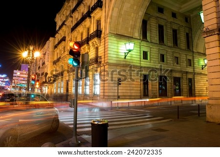 Night photo of long exposure in the city, traffic lights and pedestrian crossing