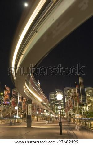 Night photo of Sydney monorail on Pyrmont Bridge, motion blur
