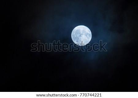 Night Photo of the full moon at the perigee point. Super Moon. A rare celestial phenomenon.