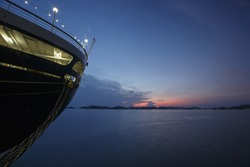Night photo of the passenger ship in port.