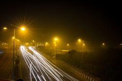 Night photography of the road transportation in the capital city of New Delhi, India. Long or Light exposure photography in New Delhi, India. Freeway in low light photography Delhi Photography - Image