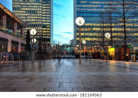 night picture of six public clock in Canary Wharf  #181169063