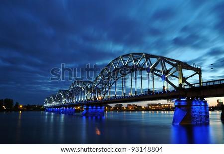 night railway bridge in Riga