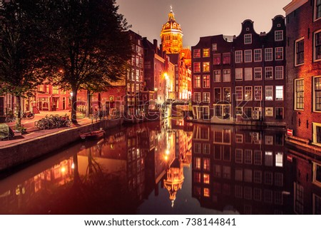Night red-light district De Wallen, canal Oudezijds Voorburgwal, bridge, Basilica of Saint Nicholas and its mirror reflection, Amsterdam, Holland, Netherlands. Used toning
