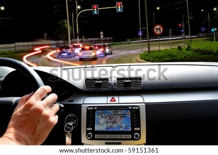 Night riding in street traffic  with gps map - stock photo