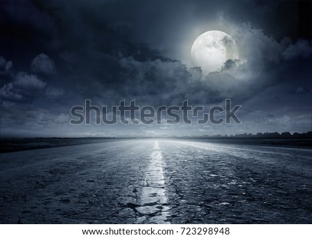 Night road against the background of cumulus clouds #723298948