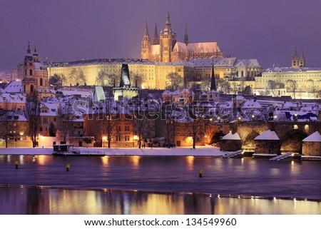 Night romantic snowy Prague gothic Castle and St. Nicholas' Cathedral, Czech republic