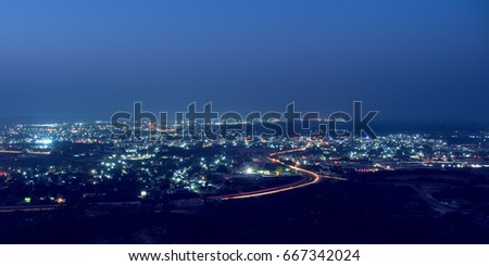 Night scape of city with lights and vehicle strikes and blue sky #667342024