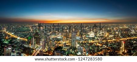 Night scene cityscape at Chaopraya river in Bangkok metropolis Thailand #1247283580