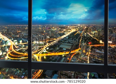 Night scene cityscape with expressway traffic shoot from window internal building in Bangkok metropolis Thailand #785129020