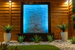 Night Scene Landscape design concept for small spaces with blue light water feature