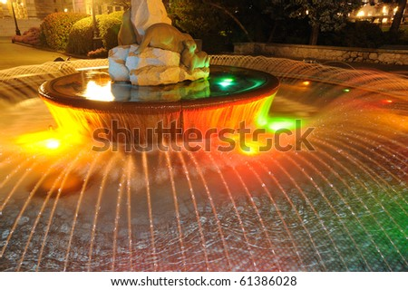 Night scene of a fountain in front of the historic parliament building at victoria downtown, british columbia, canada